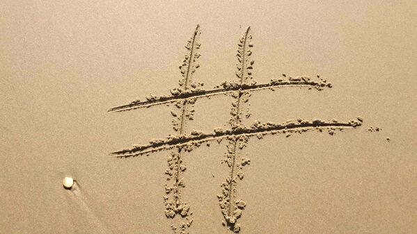 hashtag drawn in sand