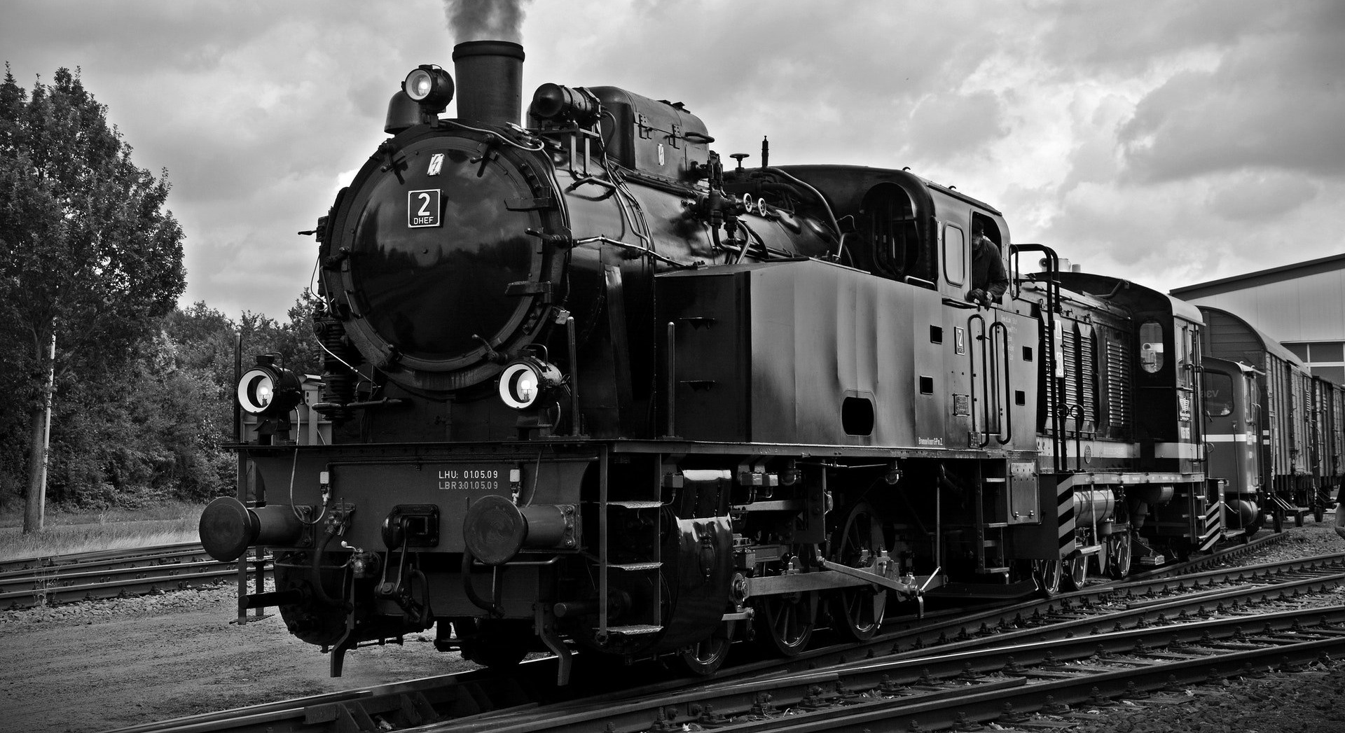 black and white steam train running on train track-616595-edited