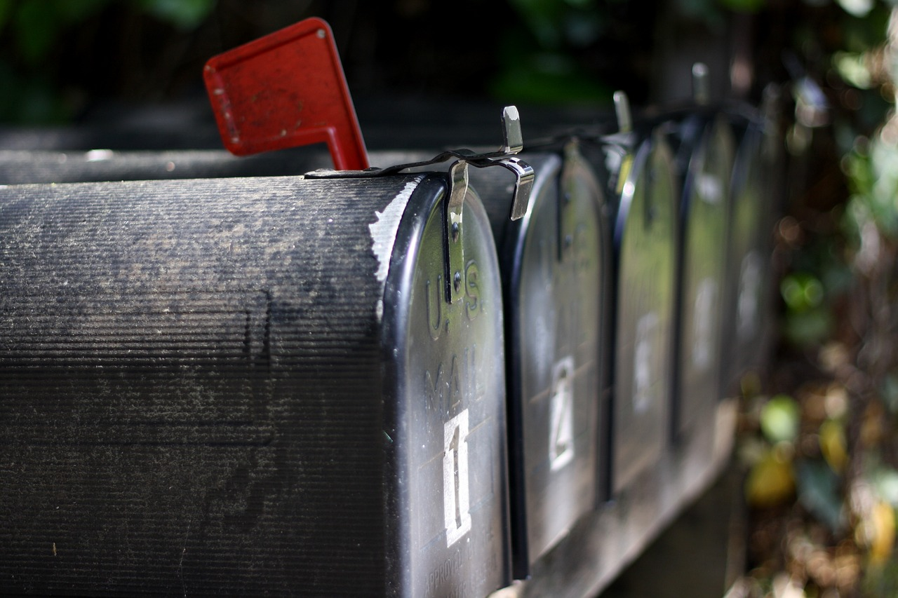 black metal mailboxes representing outsource email marketing