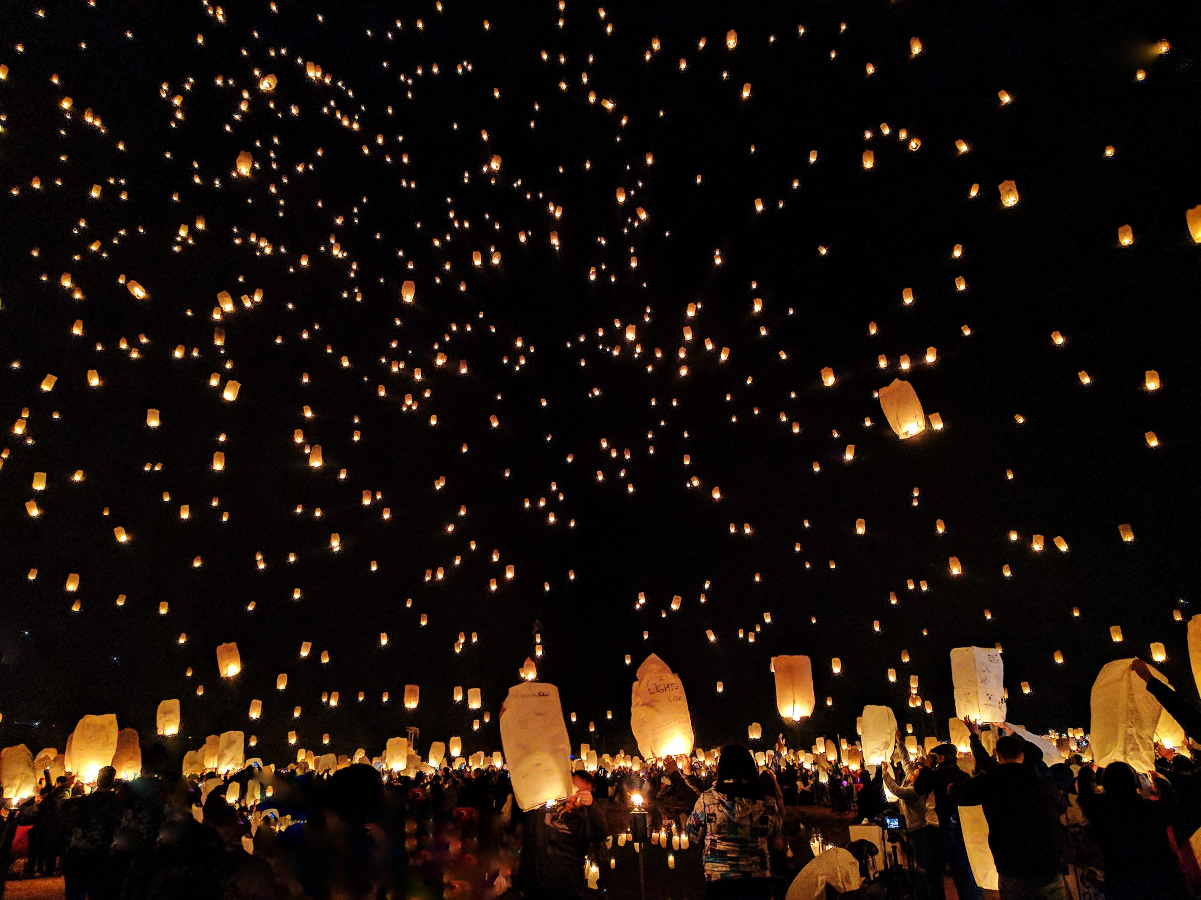 crowd delighting in sky lantern celebration