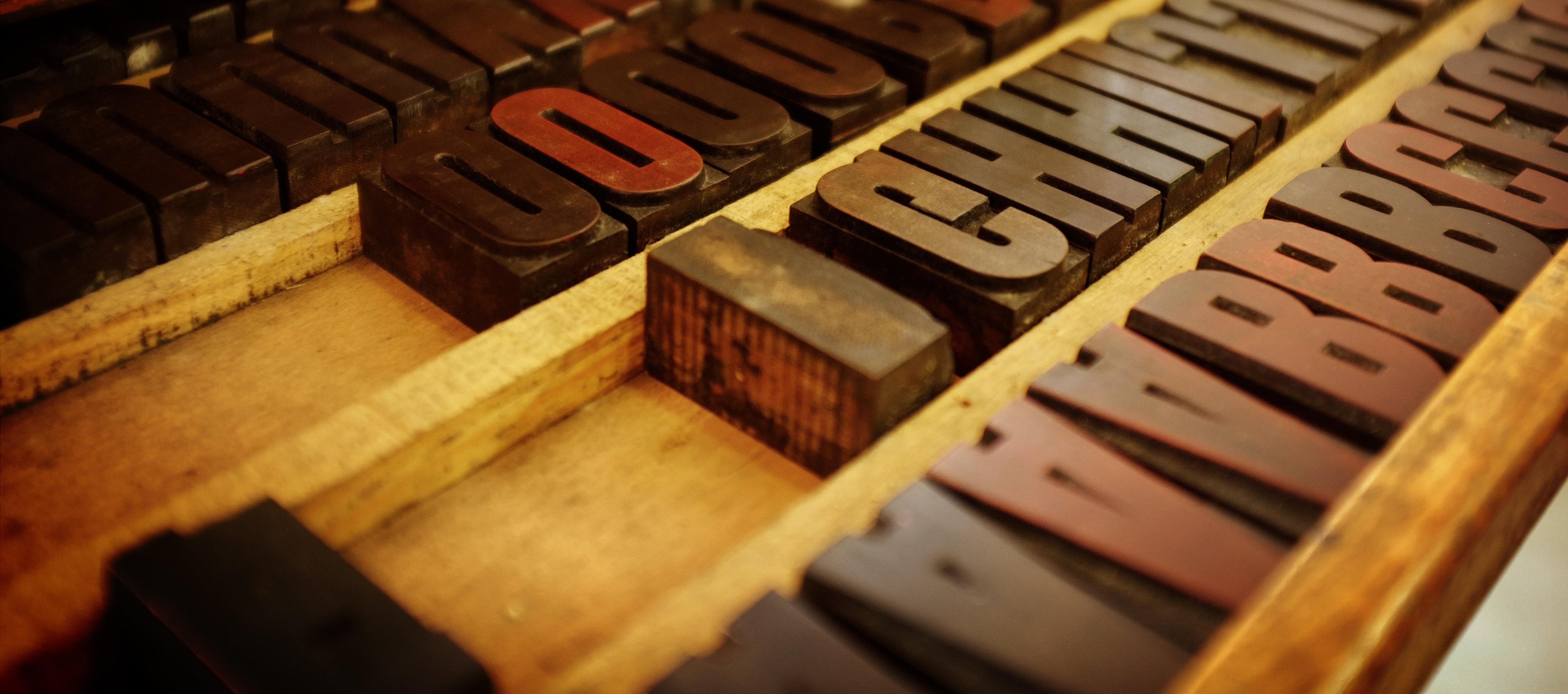 old printing press letters in wooden frame-997255-edited