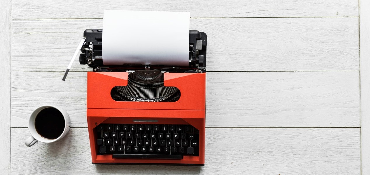 orange typewriter waiting for you to generate content that readers can't ignore-1