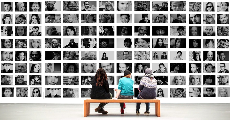 people sitting in front of a wall of photos