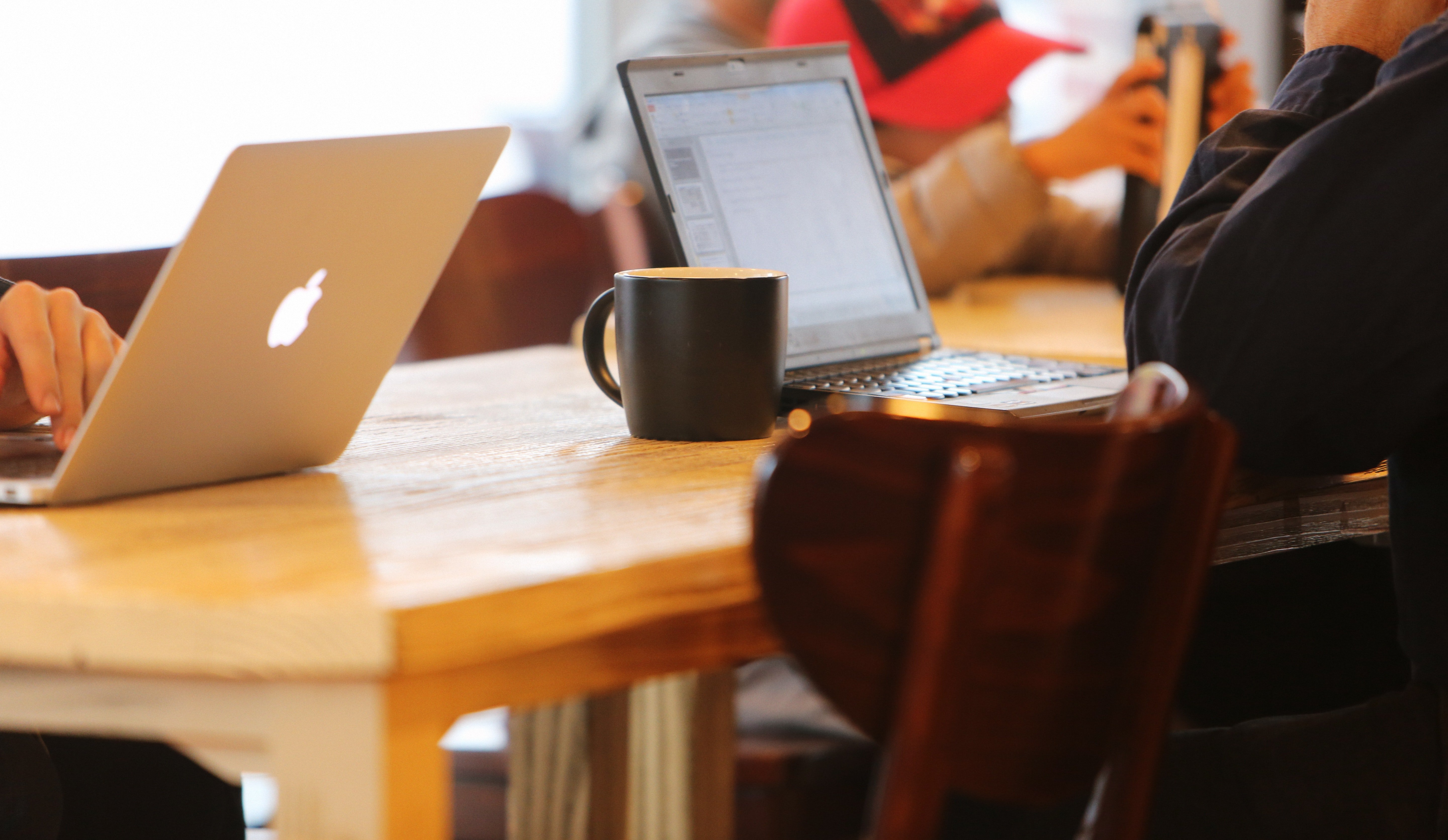 people-sitting-at-table-with-laptops-and-coffee-004207-edited