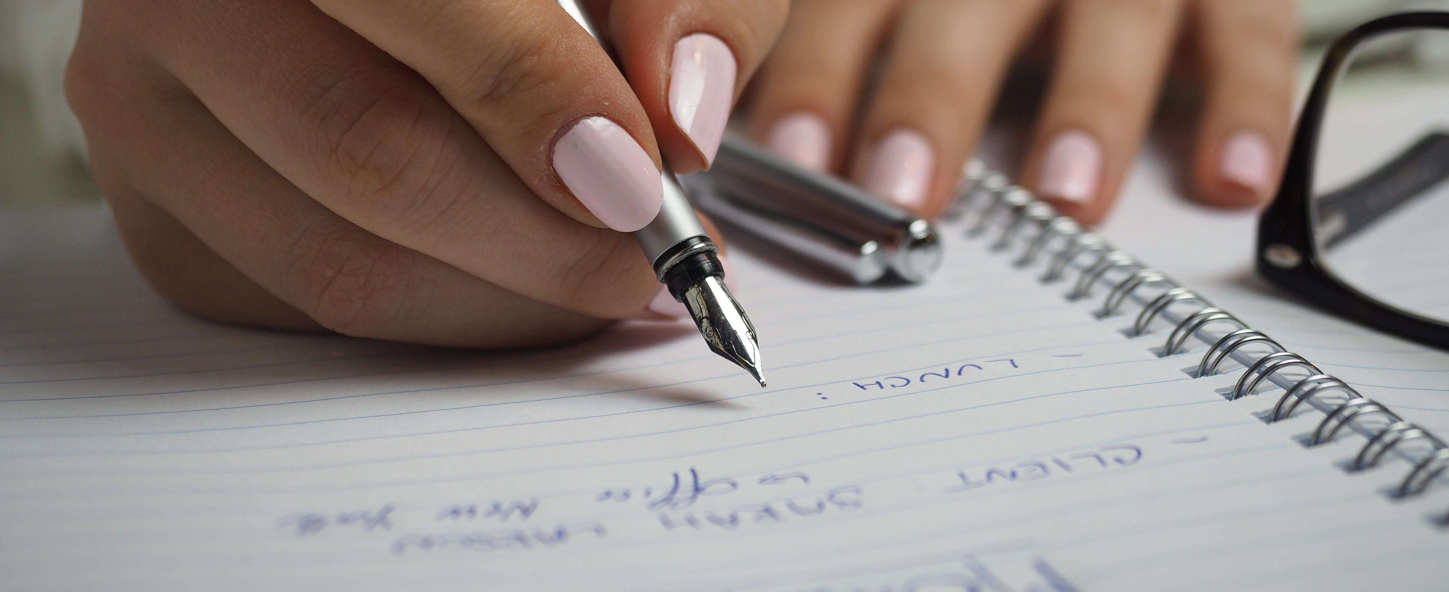person-writing-in-notebook-835933-edited