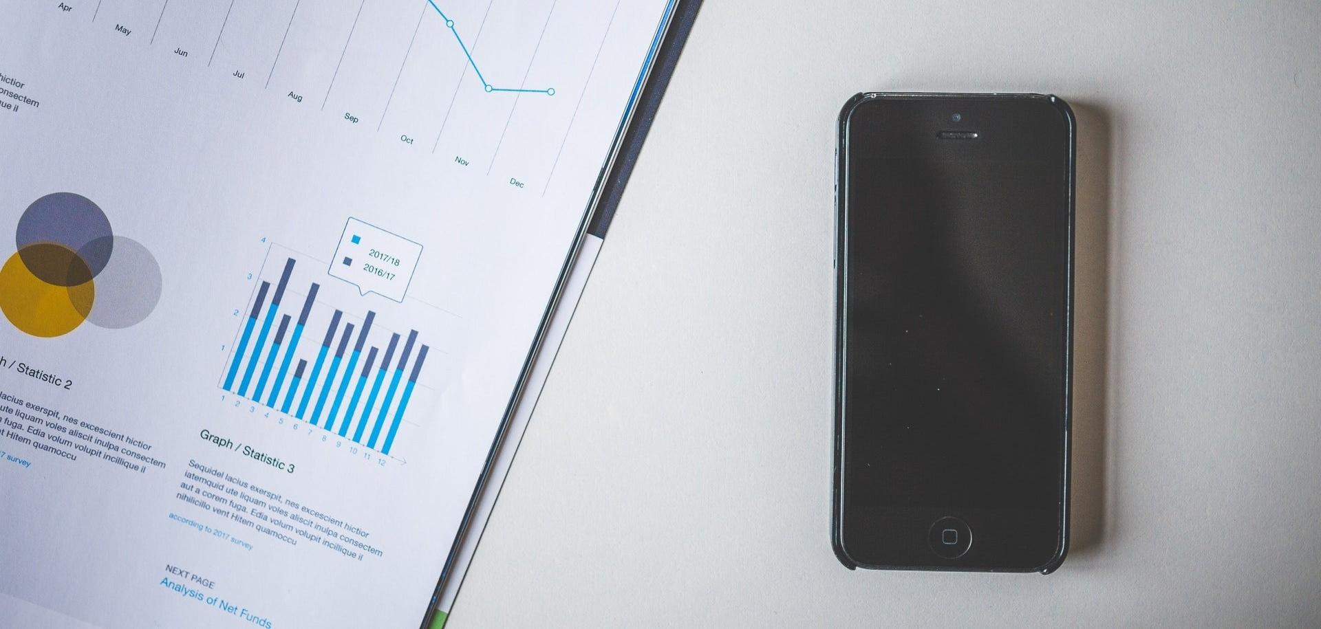 smartphone and document with analytics data-087925-edited