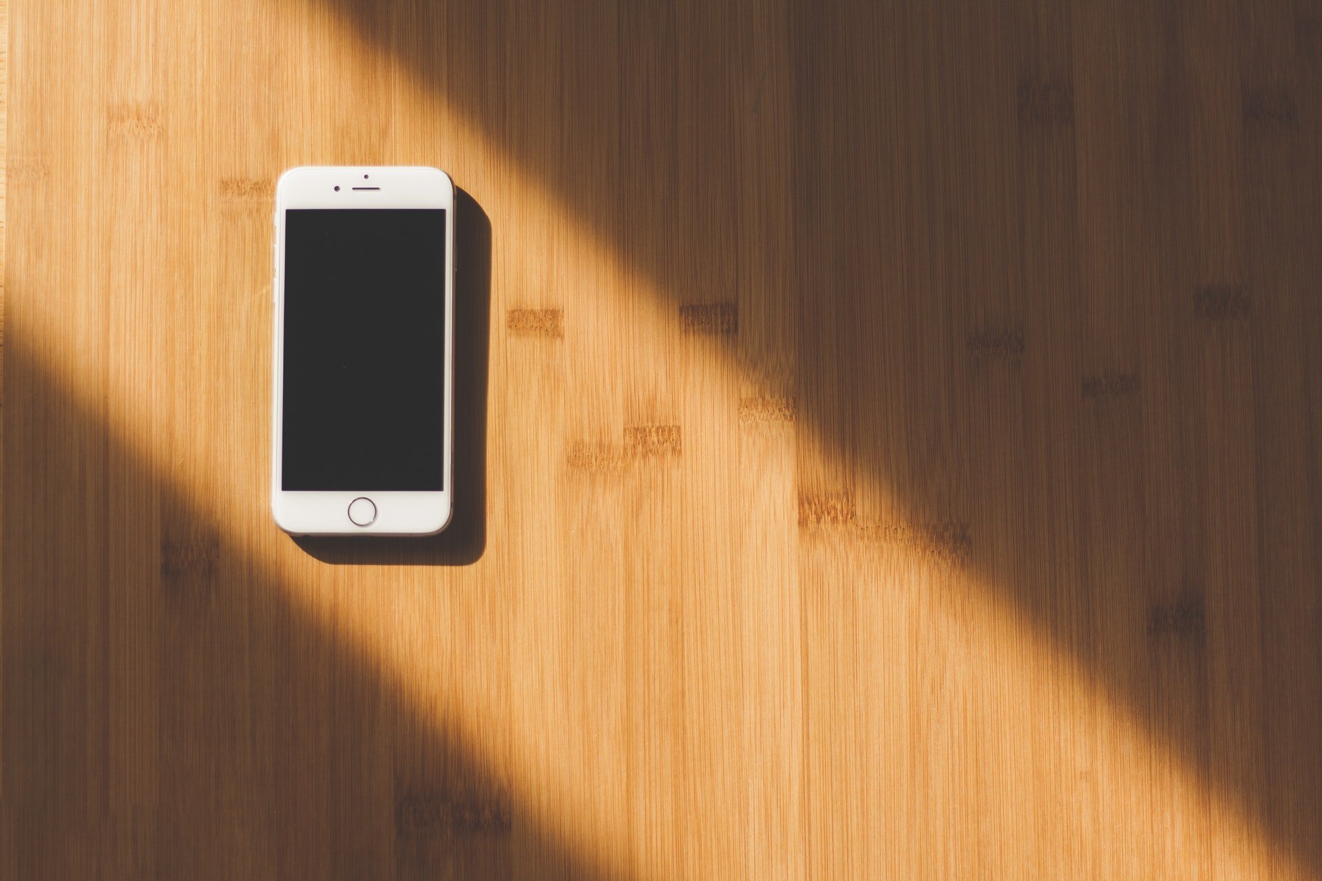 smartphone on floor in beam of light