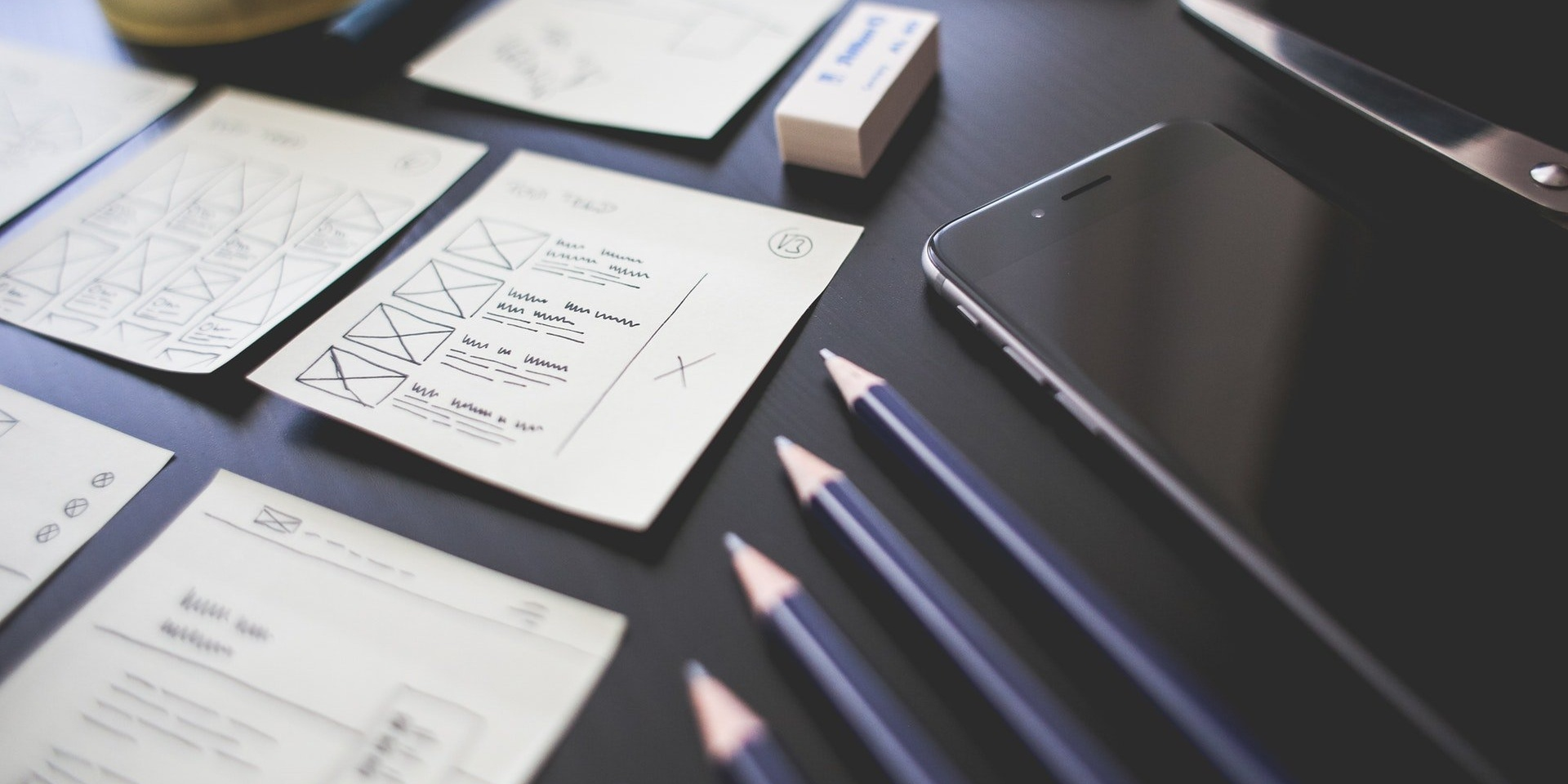 web designs and pencils neatly organized on desk-022061-edited